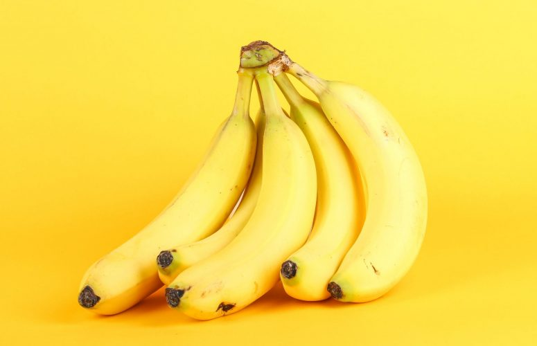 Bannas in front of a yellow wall