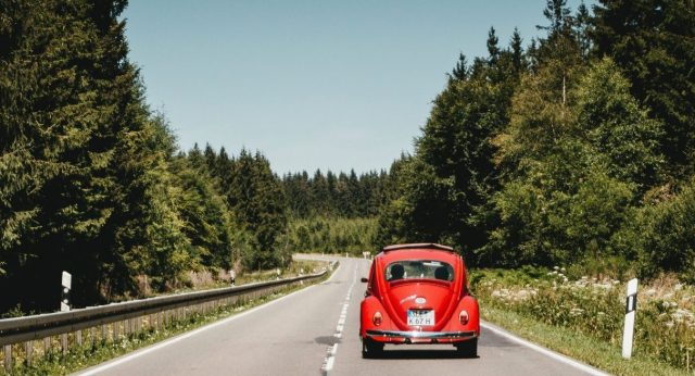 A car driving on a road in the Eifel